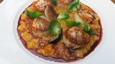 Sea Scallops Risotto, pumpkin risotto, brussel sprout leaves, cabernet black pepper reduction