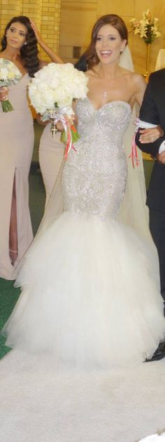 Beaded wedding gowns can be expensive.  But our dress company can recreate this strapless bridal gown for a great price.  We are near Dallas Texas but provide custom #weddingdresses to brides from all over the globe.  We also specialize in making #replicas of haute couture designs for brides on a tighter budget.  Pricing and more info on how we work with long distance brides can be obtained at www.dariuscordell.com