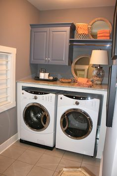 Laundry space cabinets + shelving