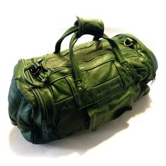 Vintage Vibrant Green Leather Duffle Bag Carry On Luggage by Vinylpie on Etsy https://www.etsy.com/listing/516297681/vintage-vibrant-green-leather-duffle-bag