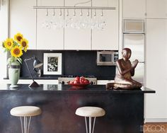 In a Manhattan penthouse, the kitchen's crystal light fixture is from Moss. The…