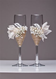 White Rustic Chic Wedding glasses with rope Rustic wedding country rustic wedding Set of 2 rustic wedding decor rustic champagne flutes  For these : white ivory satin ribbon, flower handmade, rope, brooch pearl handmade. All completely handmade! MEASUREMENTS: -Champagne flutes : Height - 9 inch (22 sm). Volume – 170ml (6.1 oz)  Custom champagne glasses may be created to fit your needs. Your unique wedding colors can be used for this design. Names and date may be painted to customize to your…