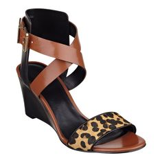 """Meow! We think you'll love our Nofrills streamlined crisscross strap wedge heels. These open toe sandals feature chic wedge heels and a sleek leopard print band across the vamp. Adjustable buckle closure. Padded footbed for all-day comfort. Leather upper. Man-made lining and sole. Imported. 2 3/4"""" mid heels. Shoes for women."""