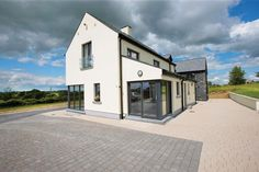 Paul & Lindy Browne are a couple who quite literally went the extra mile to source & check everything that they wanted for their new house in Co Westmeath. Architectural Technologist, Gable Window, Upside Down House, Shed With Loft, Farmhouse Renovation, Build Your Own House, Story House, Log Homes, Exterior Design