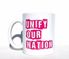 Bridge the divide and heal the wounds of our nation. Raise awareness and bring world peace and harmony about. Spread the love coffee mug.