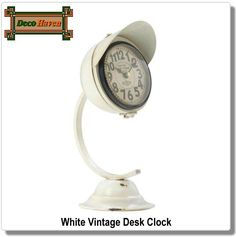 White Vintage Desk Clock - This unique white clock will brighten your room while keeping perfect time! The iron framework features a bell-shaped base, curved arm, and a cool clock with an iron visor. It adds a dash of vintage charm to any space.  Only $25.16 plus FREE shipping!