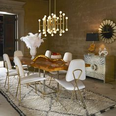 A deluxe dining room begins and ends with fancy chairs. Create a decadent dining experience by mixing hard glamour, sumptuous fabrics, and polished surfaces.
