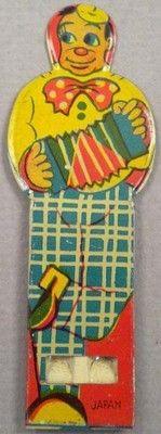 1950s tin whistle- clown playing an accordion