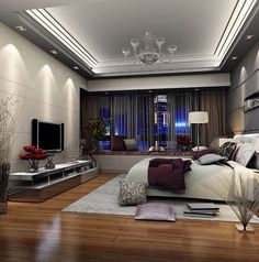 Love the can lights above the TV to showcase entertainment area! Also, love the ceiling to floor curtains!