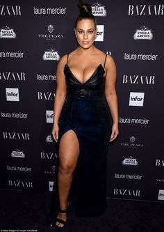 Wow: Ashley Graham looked incredible in a black and blue dress that put her ample bosom and sculpted thigh on full display