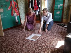 Yvonne Smith, Brintons Archivist with Tom Boggis, Curator, English Heritage at Audley End House looking at the original design papers.  Designs from Brintons archive were used to transform the recently renovated Nursery Suite at Audley End House. Two designs were selected, a small all over floral pattern and a pretty scroll, both dating from the (early) Victorian period.