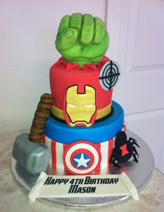 Avengers cake INCLUDING Hawkeye and Black Widow! Love that the fist is busting out of the cake*****
