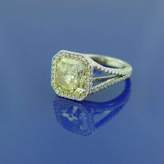 A Fancy Yellow Diamond and Platinum  Ring | From a unique collection of vintage engagement rings at http://www.1stdibs.com/jewelry/rings/engagement-rings/