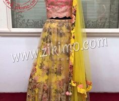 ZIKIMO PARTY WEAR YELLOW FLORAL LEHNEGA WITH PINK CHOLI