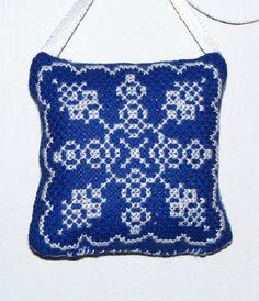 Cross stitch snow flake ornament.