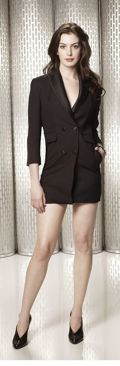 Anne Hathaway long legs in a tuxedo jacket and high heels