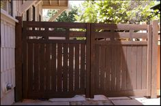 One goal for us this summer is to enclose part of our driveway. We want to have an area that Ben (who finally, at almost 11 months, had his. Driveway Fence, Backyard Gates, Backyard Plan, Front Yard Fence, Fenced In Yard, Front Yard Landscaping, Backyard Ideas, Wooden Fence Gate, Backyard Projects
