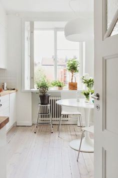 A pretty Stockholm space in pastels. Tulip table
