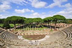 The Theatre and, in the background, the Market square of Ostia Antica, at the mouth of the River Tiber, Ostia, Rome, Italy