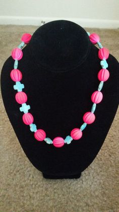 Pink and turquoise cross necklace on Etsy, $15.00