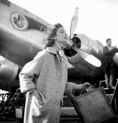 Suzy Parker wears a coat by Jamica in a photo by Georges Dambier for ELLE, Morocco, 1953