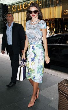 Miranda Kerr: Erdem top and skirt, Lanvin shoes, Miu Miu sunglasses, and Prada bag