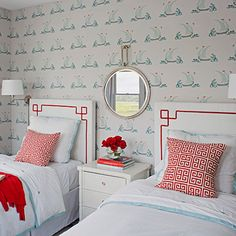Wrightsville Beach, NC Guest Room designed by Liz Carroll The unexpected color combinations in the guest room's charming Katie Ridder wallpaper inspired Carroll to think outside the box. She borrowed the poppy red color from the tiny flag atop the illustrated ships and used it for the Greek key motif on the pillows and custom twin headboards, and again for the wide trim on the curtains. The headboard and curtain fabrics are by Duralee (white) and Pindler & Pindler (red). Inset: The dresser…