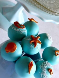 ocean themed beach wedding cake pops with shells and starfish on top