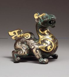 Western Han Chinese Bronze Mythical Animal with Gold and Silver Inlay Bronze with gold and silver foil inlay, 2nd century B.C.E.