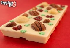 Created by Team Happiness Bars for a dear one in our family is this white chocolate bar with pecan nuts, macadamia nuts, honey roasted almonds, green stars and cranberries! :)