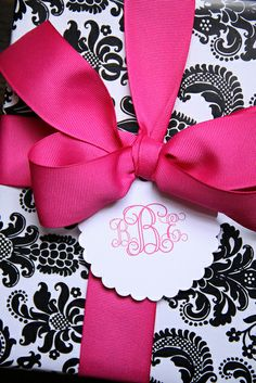 preppy paper designs.  black and white damask wrapping + hot pink gros grain ribbon and monogrammed gift tag.