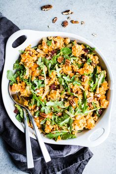 Roasted Sweet Potato Salad with Arugula and Millet combines chickpeas, cranberries, and pecans for a flavorful dish. Gluten-free, vegan, and dairy-free. Sweet Potato Cornbread, Sweet Potato Bread, Cubed Sweet Potatoes, Sweet Potato Brownies, Salad With Sweet Potato, Sweet Potato Soup, Sweet Potato Recipes, Roasted Sweet Potatoes, Potato Salad