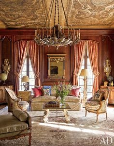 A bronze-and-tole chandelier once owned by Napoléon III is suspended under the library's 16th-century Italian painted-canvas ceiling panels. The sofa is upholstered in a Rubelli velvet, the 18th-century Italian mirror is flanked by French doors curtained in a Fortuny cotton, the floor lamp and cocktail table are from Mac Maison, and the bergères date from around 1780.