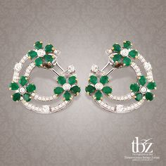 Emeralds and diamonds come together to form this exquisite pair of earrings.