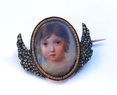 Portrait Miniature Mourning Brooch- An exquisite enamel miniature of a young girl, circa 1820. The hint of dark clouds and rose-cut diamond wings denote it as a most poignant mourning piece for a young child.