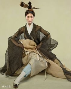 Neat crinoline and sheer sleeves- Vogue Korea