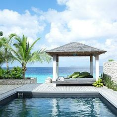 This pool-side gazebo is the ideal spot to relax and take in a beautiful view. coastalliving.com