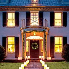 Create a Warm Welcome | Our favorite way to light up the season is with a brilliant array of paper luminaries. Line them along front walks, driveways, and porches for a fiery Christmas display that's so simple (and affordable) to pull off.