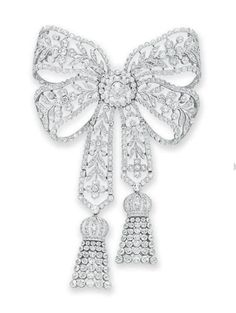 A BELLE EPOQUE DIAMOND BOW BROOCH   Designed as a pierced old European and rose-cut diamond bow of foliate motif, suspending two articulated old European and rose-cut diamond ribbons with collet-set diamond tassel terminals, mounted in platinum, circa 1910
