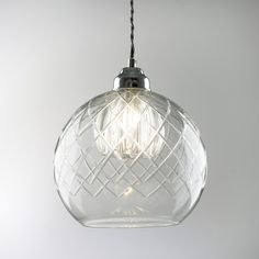 Gabby Glass Ceiling Pendant Light       This stunning glass ceiling pendant light features a cut-glass outer encasing a moulded glass shade in the centre.