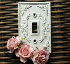 Shabby light switch cover.