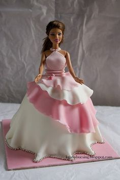 Barbie cakes are so popular now for girl's birthday parties but I like how the skirt on this one is different than a lot you see!!!