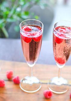Unicorn Tears -- Gin, Chombard, St. Germaine, Peach Schnapps, Prosecco Raspberries (optional)