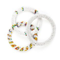 Handmade in Kenya, these different shades of white and white with coloured sprinkled Maasai beaded bangles fit all sizes and brighten up any outfit. Select your preferred colour, or a set of all three from the drop-down menu. ----- About the brand Love'edu: Lov'edu Living was founded by Ibiza raised Anna Boettcher in 2013 in London. Today, Lov'edu is both a physical and an online ethical store that offers unique interior decoration, accessories, jewellery and lifestyle products. All items…
