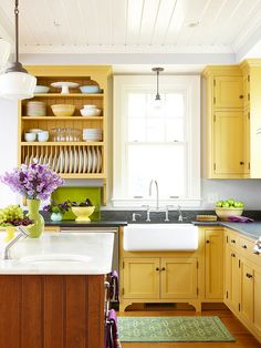 yellow cabinets, white beadboard ceiling, grey counters.