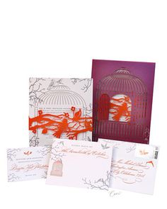 Custom-Designed Wedding Invitations    Ceci New York created these custom-designed, letterpress wedding invitations, which echo the bird and branch elements at Carter and Fred's formal wedding. A laser-cut sleeve reminiscent of a birdcage slips over each invitation, and the door can be opened to see the orange bird on the band underneath. On the outer envelope is a custom postage stamp with the same bird illustration.