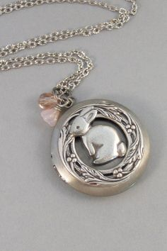 This lovely antique silver locket has an antiqued silver little rabbit adorned to the center. I have surrounded this sweet little rabbit with a flowered vine. I have added a tiny pink Swarovski bead and a small pink flower bead to this locket. The both hang from a small connector piece.  **If you choose the added birthstone option you will receive the locket pictured and I will add a small birthstone to the top of the locket to dangle from the chain. Please leave your birthstone color in the…
