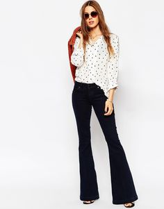 """Flare jeans by ASOS Collection Cotton-rich denim Low-rise waistband Zip fly Five pocket styling Flared fit - cut with a straight leg that flares at the ankle Machine wash 99% Cotton, 1% Elastane Our model wears a UK 8/EU 36/US 4 and is 173 cm/5'8"""" tall"""