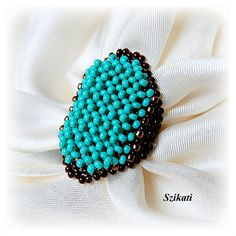 Beaded turquoise & brown seed bead Right Angle Weave ring $30.00