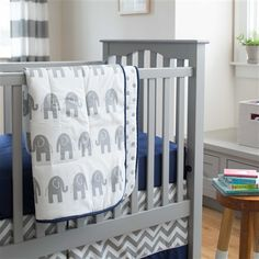 Navy and Gray Elephants Crib Comforter made with care in the USA by Carousel Designs. Measures approximately wide by long. Elephant Crib Bedding Set, Elephant Themed Nursery, Baby Crib Sheets, Baby Boy Cribs, Baby Crib Bedding Sets, Gray Bedding, Bed Sheets, Diy Crib, Carousel Designs